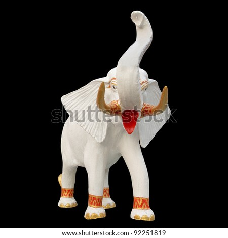 White elephant statue isolated on black