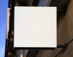 White empty board symbol over the entrance of the store