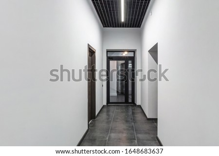 Photo of  white empty corridor for room office in interior of modern apartments, office or clinic