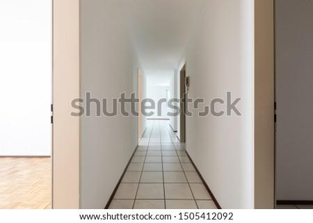 White empty corridor with tile. Nobody inside