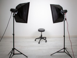 white empty photo studio room light interior for shooting models with professional photographer equipment