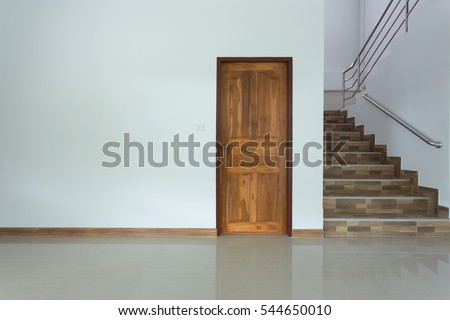 white empty room interior with wooden door and staircase #544650010