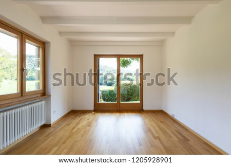 White empty room with nature view. Nobody inside