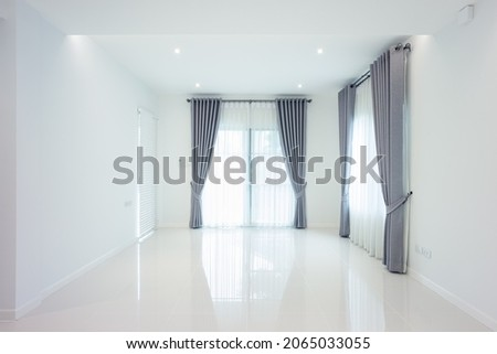 White empty space or room consist of ceramic tile floor in perspective view. Include venetian blind, curtain. Modern luxury interior home design. Look clean, bright and shiny surface for background.