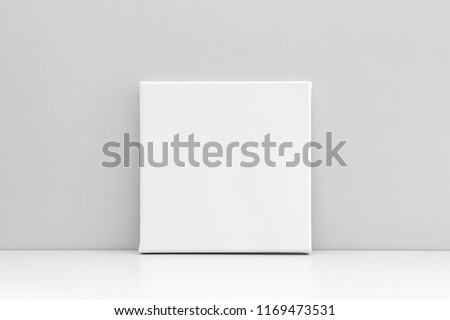 White empty square canvas on neutral gray background. Mock up poster, canvas template. #1169473531