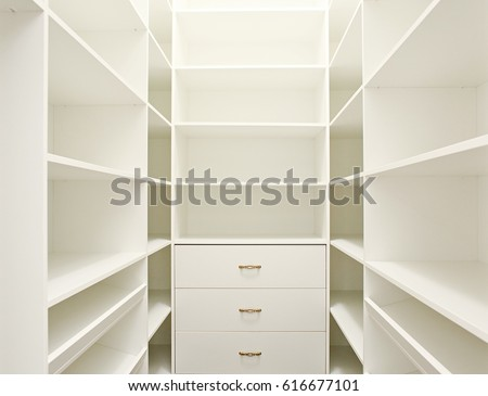 White empty walk-in closet. #616677101