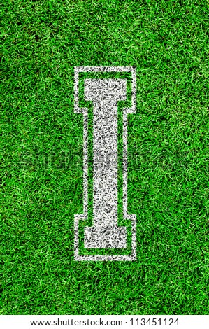 White english alphabet I on green grass