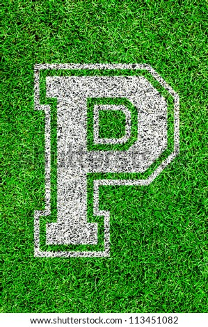 White english alphabet P on green grass