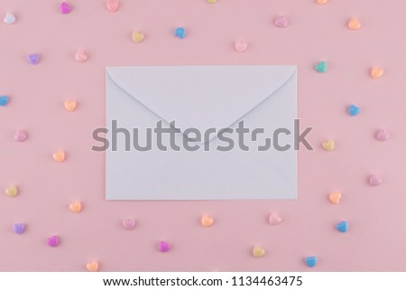 White envelop decorate with pastel heart on pink background #1134463475