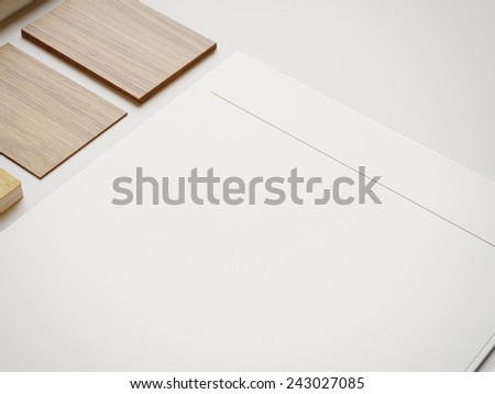 White envelope and wood cards on white paper background