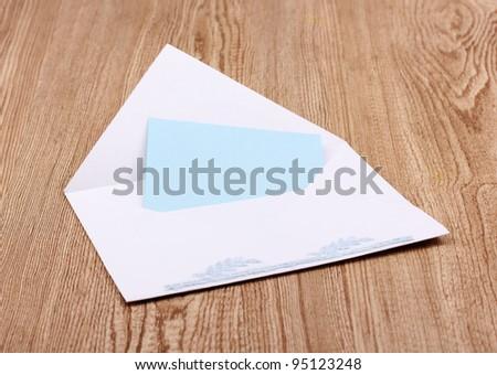 White envelope on wooden background