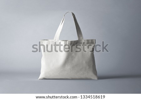White Fabric Bag isolated on gray background for Mock up.High resolution photo.