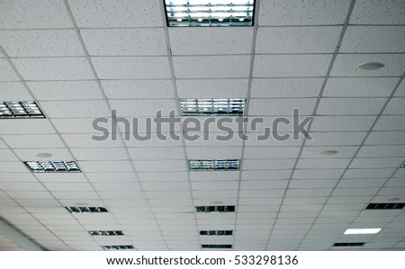 White false ceiling and incorporated lamps