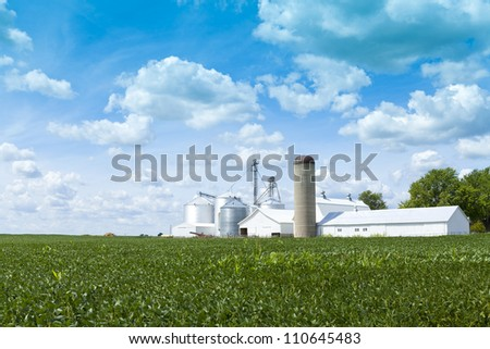 White Farm With Cloudy Sky