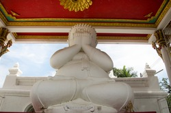 White fat buddha statue hand blind eye or see no evil buddhas statues for people praying and visit at  Wat Pa Mok Worawihan temple in Ang Thong, Thailand