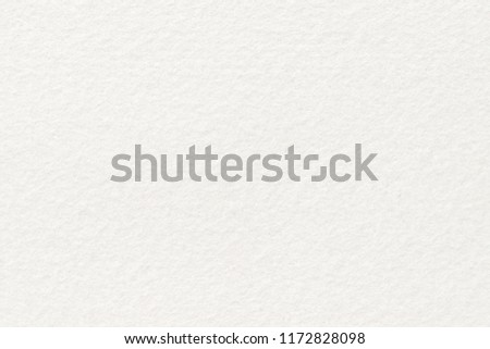 White felt background. Surface of fabric texture in cream color.