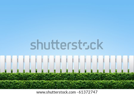 White fence and hedge on clear blue sky - stock photo