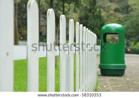 White fence around front yard of Park