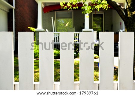 White fence around front yard of residential house