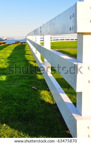 White fence receding into the distance