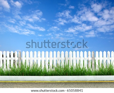 white fence with road and blue sky #65058841