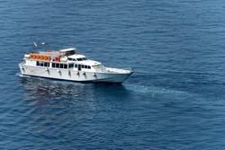 White ferry boat in the blue Mediterranean Sea. port of Vernazza, Cinque Terre, Liguria, Italy, south Europe