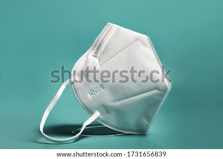 White FFP2, KN95 respirator. Dust protection respirator or medical respiratory mask against the virus. Surgical protective mask. prevention of the spread of coronavirus pandemic COVID-19 SARS-COV-2