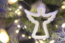 white figure of a Christmas angel on a tree