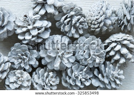 White Fir Cones On Wooden Background With Copy Space Or Your Text Here .Vintage, Retro Style Used As Winter Or Christmas Background. Close Up View. Christmas Card For Seasons Greetings