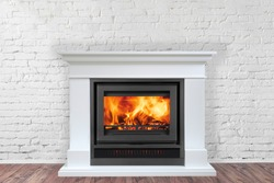 White Fireplace in bright empty living room interior of house.