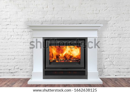 White Fireplace in bright empty living room interior of house. Stock fotó ©