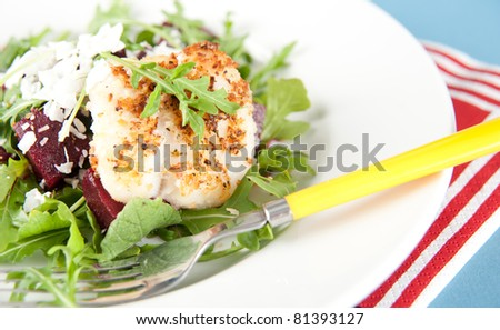 White Fish Fried in Coconut Flakes and Served with Fresh Arugula and Beets
