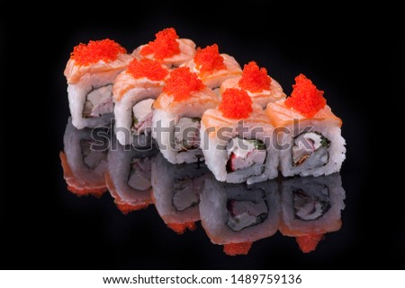 white fish sushi caviar on it isolated in black background elegant color for pictures of sushi