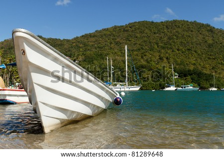 White fishing boat on Marigot Bay in the Caribbean island of St Lucia