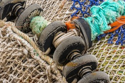 White fishing net with black wheels.