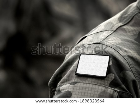 White flag on military uniform. White flag is sign of truce or surrender or ceasefire, and request for negotiation. Army, armed forces, soldiers, war and peace. Сток-фото ©