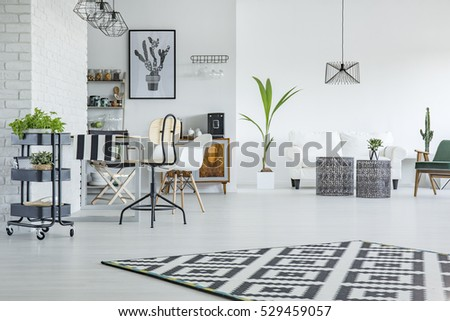 White flat with dining area and living room combined