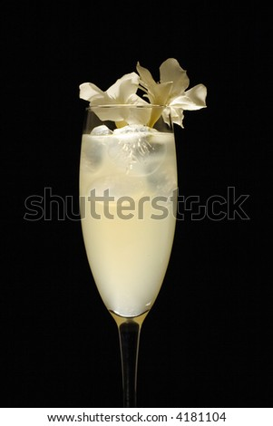 White flower decorated drink in studio light and black background