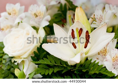 White flowers as roses and lily for the funeral