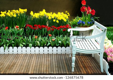 White flowers in a garden chair green,view nature tranquil landscape tree summer relaxation bush flower grass plant garden day outdoor lush foliage table lawn seat furniture comfortable front