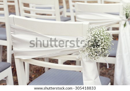 White flowers, Rustic Chic outdoor chair wedding decoration