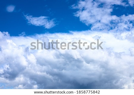 White fluffy cloud on azure blue sky. Rain weather or cyclone formation. Abstract natural photo. Cotton softness concept. Zen or relax cover template.  Cloudy sky overcast ストックフォト ©