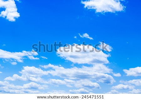White fluffy clouds in the blue sky #245471551