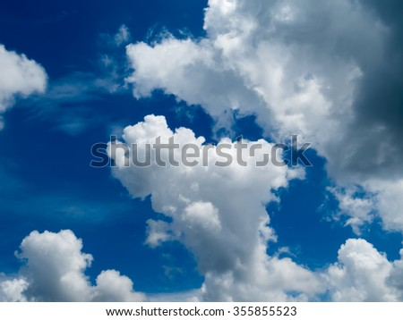 White fluffy clouds in the blue sky #355855523