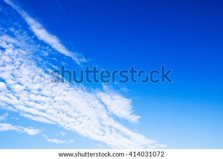 white fluffy clouds in the blue sky #414031072