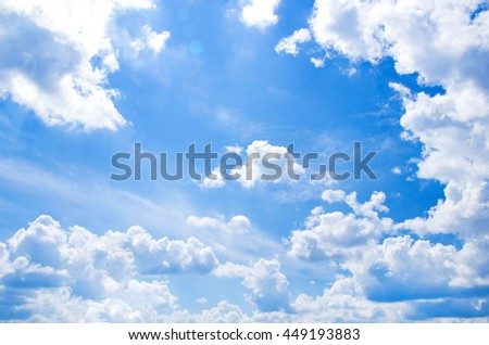 white fluffy clouds in the blue sky #449193883