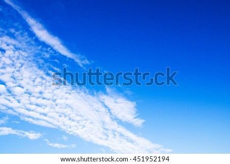 white fluffy clouds in the blue sky #451952194