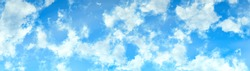 white fluffy clouds on a sky blue sky background in high resolution