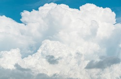 White fluffy clouds on blue sky. Soft touch feeling like cotton. White puffy cloudscape with space for text. Beauty in nature. Close-up white cumulus clouds texture background. Sky on sunny day.