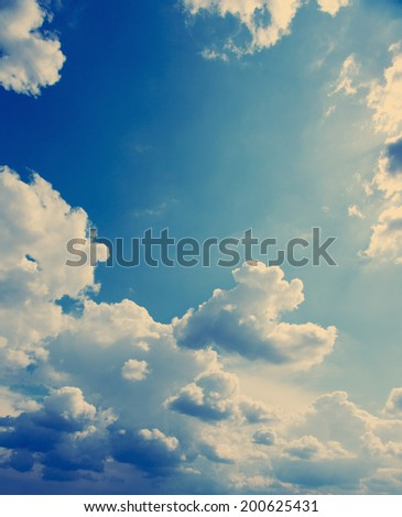 White fluffy clouds over blue sky